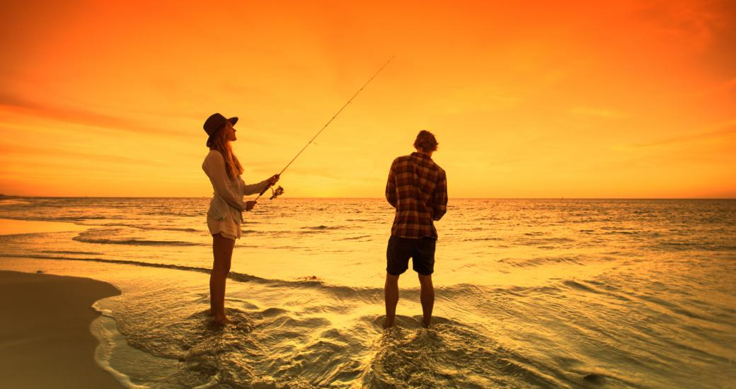 A couple fish at sunset in Coral Bay, Western Australia