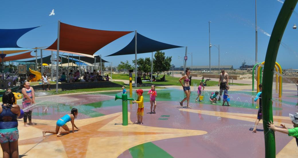 Children play in the water park on Geraldton's Foreshore, Western Australia