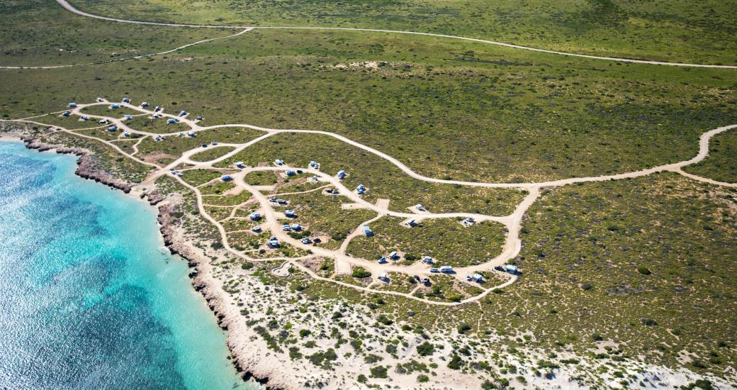 An aerial view of a beachfront campsite in Cape Range National Park, on the shores of Ningaloo Reef, Western Australia
