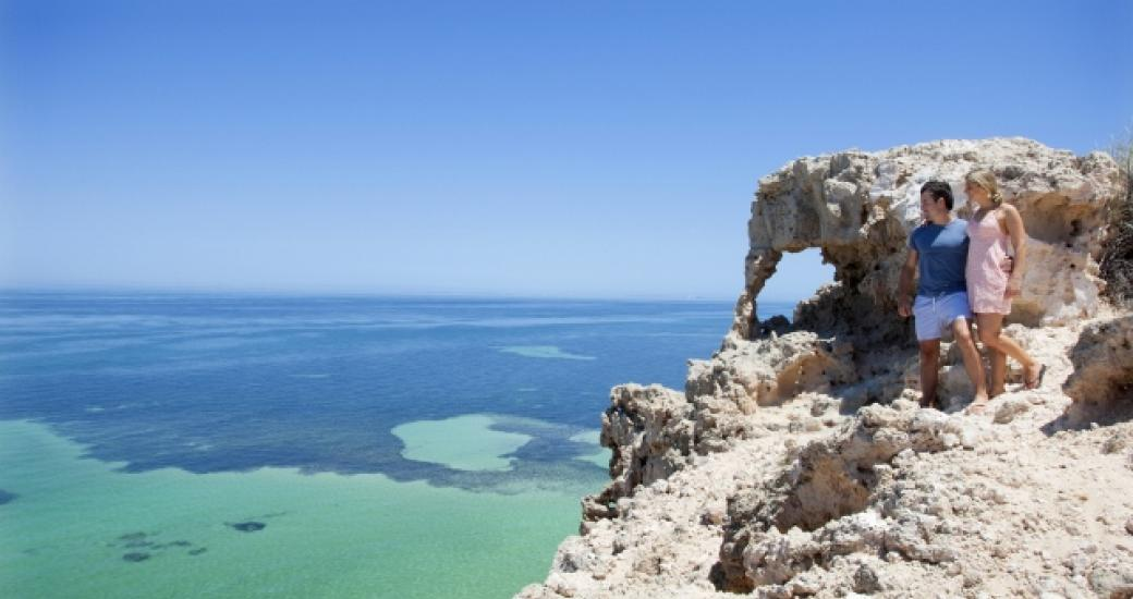A couple look out from Eagle Bluff in the Shark Bay World Heritage Area, Western Australia