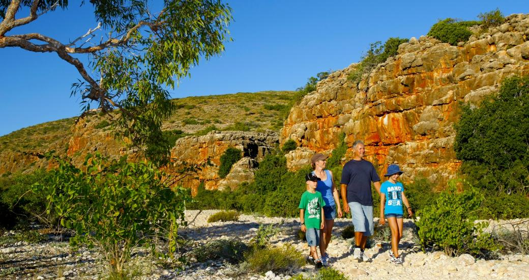 A family walk through Mandu Mandu Gorge in Cape Range National Park, near Exmouth, Western Australia