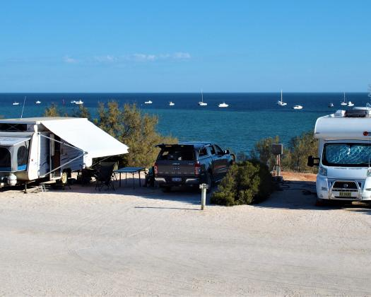 Caravans parked up on the waterfront at Denham Seaside Caravan Park, Shark Bay, Western Australia