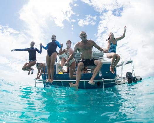 A group of guests enjoy a day out on the Ningaloo Reef with Three Islands Whale Shark Swim, Western Australia