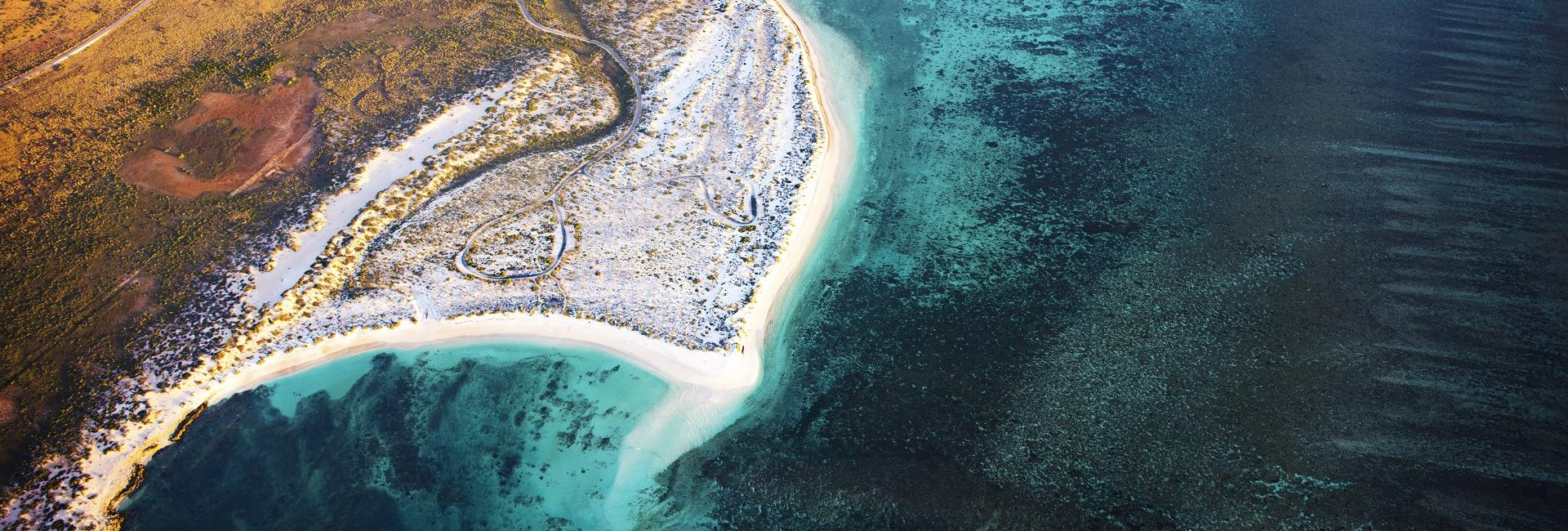 An aerial photo of Ningaloo Reef and Cape Range National Park, Western Australia. Image credit: Lauren Bath