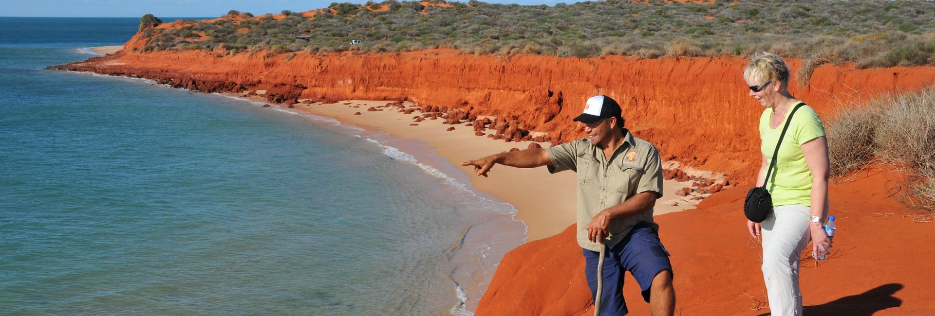 A guest on an indigenous tour in Francois Peron National Park with Darren Capewell of Wula Gura Nyinda Eco Cultural Adventures, Shark Bay World Heritage Area, Western Australia