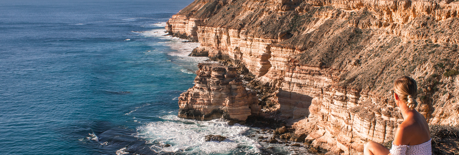 A traveller soaks up the view of Kalbarri's Coastal Cliffs, Kalbarri, Western Australia