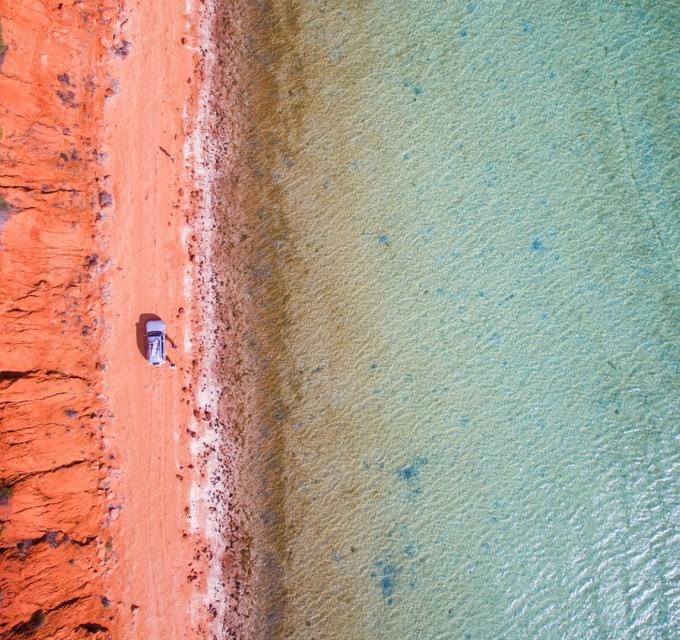 An aerial view of the contrasting red earth and blue water in the Shark Bay World Heritage Area, Western Australia