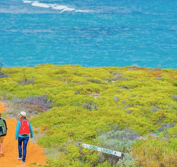 A couple walk along the Three Bays walk trail near Green Head, Western Australia