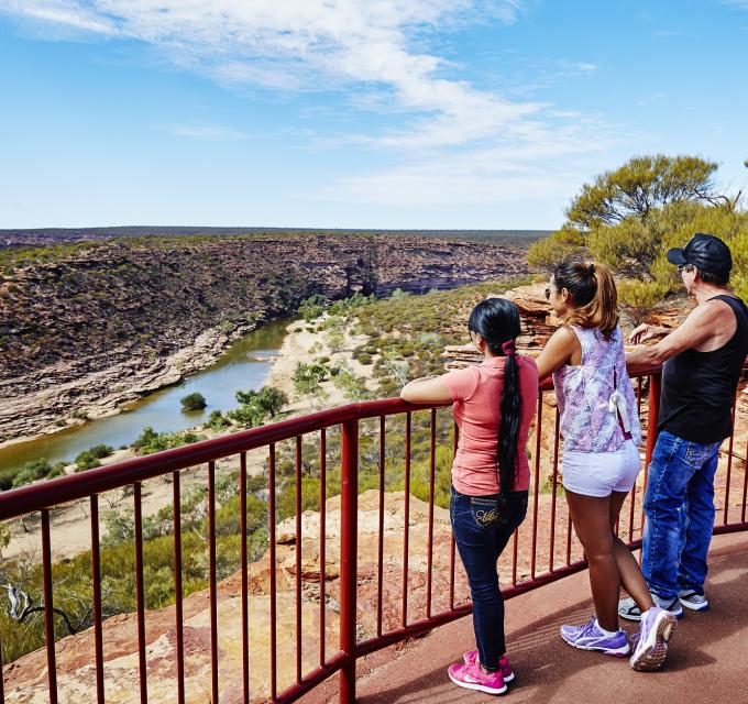Friends look out from the Z Bend Lookout in Kalbarri National Park, Western Australia