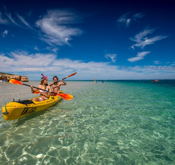 Kayaking through the waters of Ningaloo Reef in Coral Bay, Western Australia