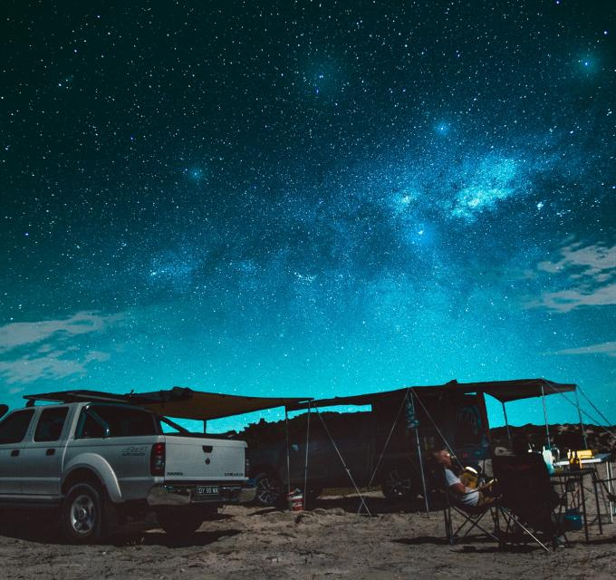 A 4WD set up beneath the starry night sky in Australia's Coral Coast, Western Australia