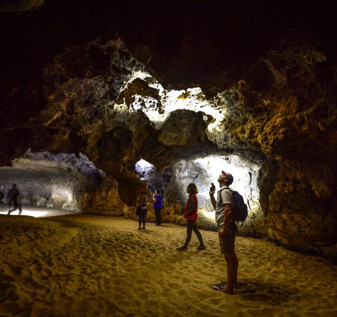 People explore Stockyard Gully cave, near Coorow, Western Australia